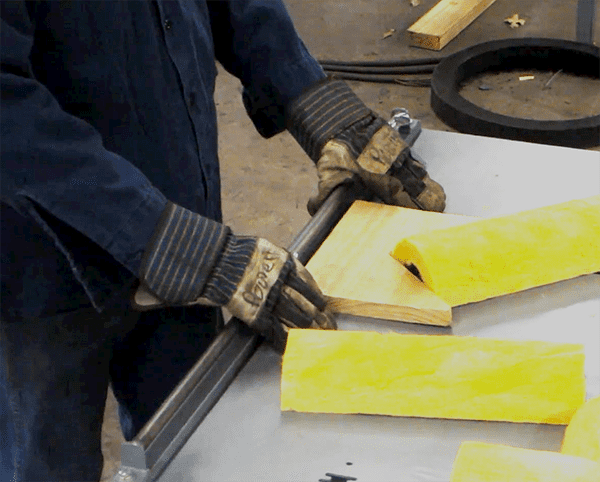 Should I wear gloves when using a bandsaw?